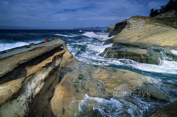 [USA.OREGON 28762] 'Cape Kiwanda.'  The sandstone escarpment of Cape Kiwanda, just north of Pacific City, is a good place to experience spectacular wave action if seas are rough. Photo Mick Palarczyk.