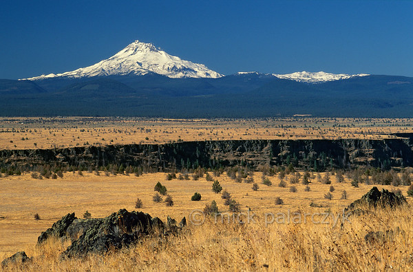 [USA.OREGON 28850] 'Prairie of Schoolie Flat.'  The prairie of Schoolie Flat is located in the center of the Warm Springs Indian Reservation. The yellow expanse of the flatland is bisected by the canyon of the Warm Springs River. On the horizon, snowcapped Mount Jefferson, a volcano in the Cascades Mountain Range, can be seen. Photo Mick Palarczyk.