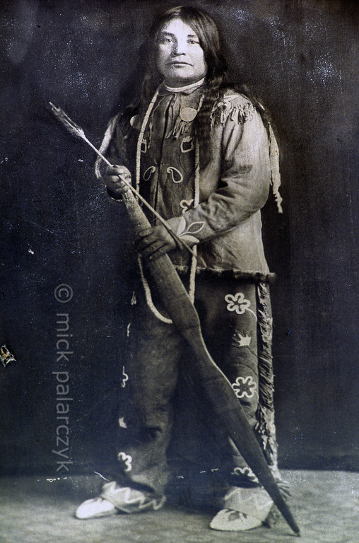 [USA.OREGON 28818] 'Portrait of Joe Kuckup.'  	A portrait from around 1900 of Joe Kuckup adorns a wall in the local drugstore of Warm Springs town. Joe was a member of the Wasco Indian tribe which organized itself with two other tribes (The Walla and the Paiute) into the Confederated Tribes of Warm Springs in 1937. Photo Mick Palarczyk.