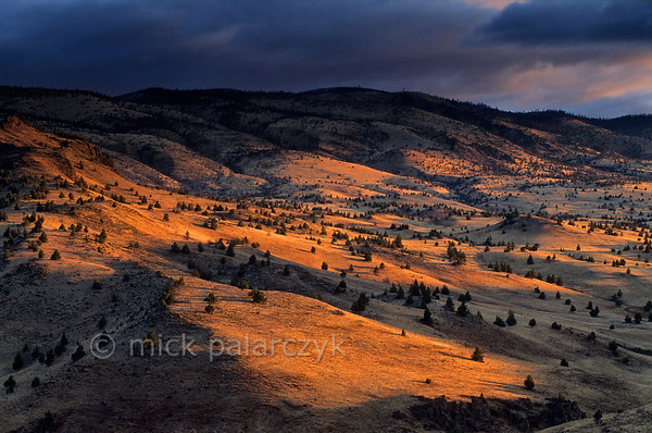 [USA.OREGON 28847] 'Valley of Warm Springs River.'  	The first rays of the rising sun play along the northern valley slopes of the Warm Springs River in the Warm Springs Indian Reservation, north of Warm Springs town. Photo Mick Palarczyk.