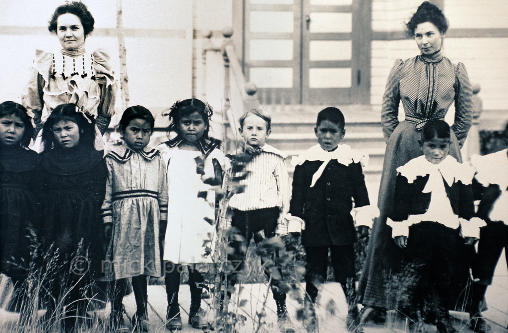 """[USA.OREGON 28819] 'Young Indians in boarding school.'  In the 1890s, young Warm Spring Indians were forced to attend boarding schools where they were alienated from their own culture. Only the English language was taught at these schools and Indian clothes were banished. In 1863 teacher Myron Reaves remarked: """"the children should be boarded by the school teacher, and entirely taken from their parents or guardians . . . : without that the school is of very little benefit to the children."""" The picture is part of the exhibition in the Museum at Warm Springs. Photo Mick Palarczyk."""