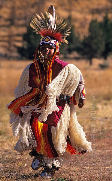 [USA.OREGON 28834] 'Indian boy.'  A young member of the Walla Walla (or Warm Springs) Indian tribe, performing a dance on the plains near Warm Springs town. Photo Mick Palarczyk.