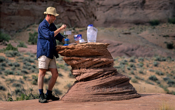 [USA.UTAH 28072] 'Dinner table.'  Hiking and camping in the Paria Canyon can have its unexpected pleasures, such as this dinner table which has been eroded out of  finely layered sandstone that was deposited in a vast desert 200 million years ago. The canyon of the Paria (a tributary of the Colorado) can be found east of Kanab and south of route 89. Photo Paul Smit.