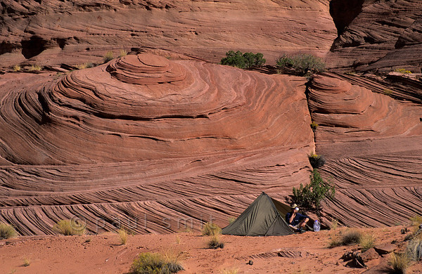 [USA.UTAH 28057] 'Camping in the Paria Canyon.'  	There are no campsites in the Paria Canyon but for hikers with a permit camping wild is allowed. The canyon of the Paria (a tributary of the Colorado) can be found east of Kanab and south of route 89. Photo Paul Smit.