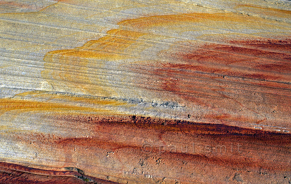 [USA.ARIZONA 28009] 'Coloured bands in Navajo Sandstone.'  	Navajo Sandstone, seen here in The Wave (Vermilion Cliffs Wilderness) is composed primarily of wind-blown sand from a vast ancient desert. Minerals of iron oxide, deposited by groundwater after the accumulation of the sand, have created red, orange and yellow bands. Photo Paul Smit.