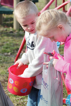 Kids check their baskets after the Stewardson Lions Club Easter Egg Hunt at Stewardson Village Park.