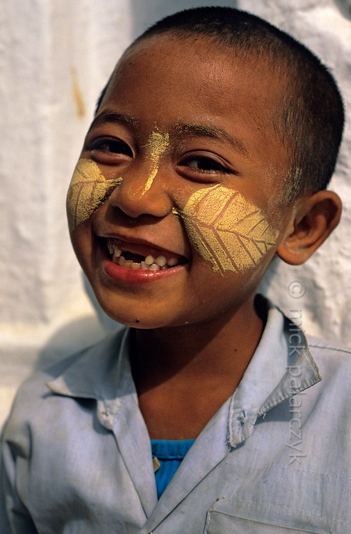 [BURMA 25.020] 'Leafy boy.'  	Boy with thanaka make-up in leaf pattern at Mandalay. Photo Mick Palarczyk.