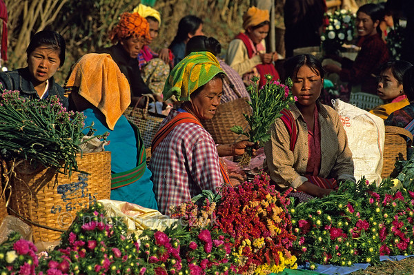 [BURMA 24.777] 'Market of Kalaw.'  	Highland women selling flowers on the market of Kalaw. Photo Mick Palarczyk.