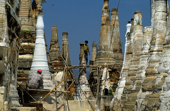 [BURMA 24.867] 'Restoring stupas.'  	At Indein, a village on the west shore of the Inle Lake, restoration work has started at the dilapidated Shwe Inn Thein Pagoda complex (founded in the 11th century). Photo Mick Palarczyk.