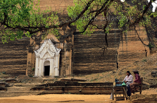 [BURMA 25.067] 'Mingun.'  	Construction of the massive brick stupa of Mingun, north of Mandalay, started in 1790. Its intended height was 150 m., but when the work halted in 1819 only the 50m high base was finished. This was badly cracked by the earthquake of 1838. Photo Mick Palarczyk.