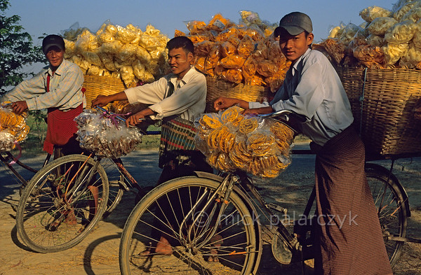 [BURMA 24.757] 'Transporting crisps.'  	Boys transporting crisps on the road north of Tatkon. Photo Mick Palarczyk.