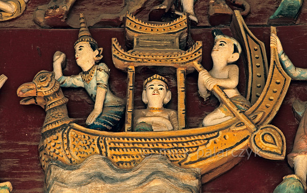 [BURMA 24.671] 'Bird headed barge.'  At Nyaung U, north of Bagan, a woodcarving in the Yukeson Hall of the Shwezigon Pagoda shows the mythological karaweik or Burmese crane on the bow of a barge. Photo Mick Palarczyk.
