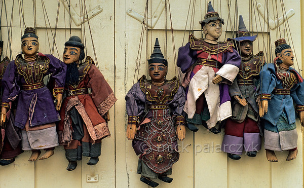[BURMA 25.085] 'Marionettes in Mandalay.'  	A display of marionettes in a shop at Mandalay. Photo Mick Palarczyk.