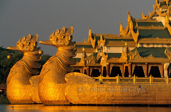[BURMA 24.670] 'Bird headed restaurant.'  At the eastern edge of Yangon's Kandawgyi Lake sits the Karaweik Restaurant. Built in the 1970s, this non-floating reproduction of a royal barge boasts two heads of the karaweik or Burmese crane. Photo Mick Palarczyk.