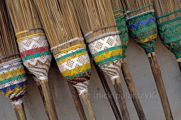 [BURMA 24.983] 'Decorated brooms.'  	Decorated brooms in a shop at Monywa. Monywa is a town on the bank of the Chindwinn River, a tributary of the Irrawaddy. Photo Mick Palarczyk.