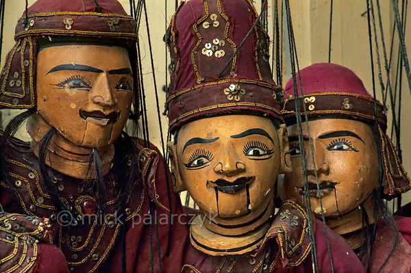 [BURMA 25.082] 'Marionettes in Mandalay.'  A display of traditional Burmese marionettes in a shop at Mandalay. Photo Mick Palarczyk.