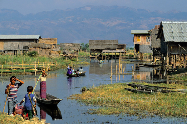 [BURMA 24.811] 'The end of a school day.'  	At the end of a school day, Inle Lake villagers take their children home by boat to their stilted houses in Kaungdaing, on the northwestern shore of the lake. Photo Mick Palarczyk.