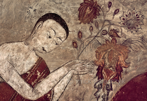 [BURMA 24.922] 'Offering flowers.'  	On this fresco from the Konbaung period (18-19th century) in Bagan's Sulamani Temple, a worshipper is offering flowers to Buddha. Photo Mick Palarczyk.