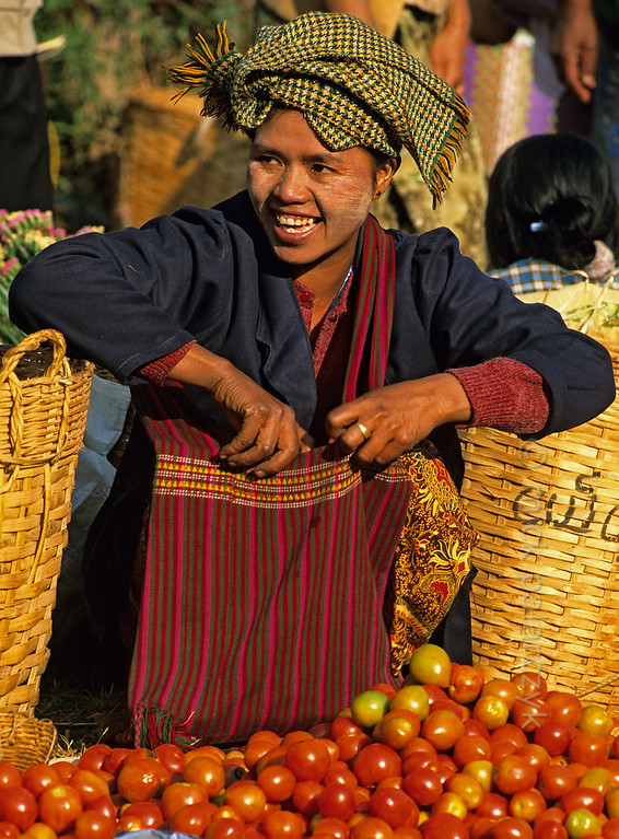 [BURMA 24.778] 'Selling tomatoes.'  	Selling tomatoes on the market of Kalaw. Photo Mick Palarczyk.