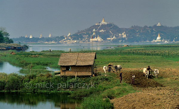 [BURMA 25.028] 'Sagaing hills.'  	South of Mandalay, many temples and monasteries cover the Sagaing hills, seen here from across the Irrawaddy River. Photo Mick Palarczyk.