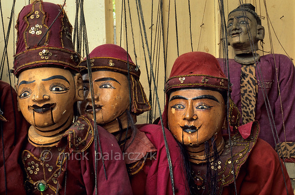 [BURMA 25.080] 'Marionettes in Mandalay.'  	A display of traditional Burmese marionettes in a shop at Mandalay. Photo Mick Palarczyk.