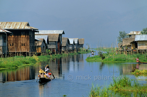 [BURMA 24.804] 'Maing Thauk village.'  	The individual stilted houses of Maing Thauk, a village in the Inle Lake, can only be reached by boat. Photo Mick Palarczyk.