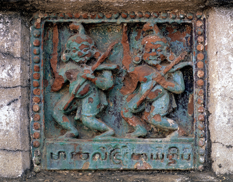 [BURMA 24.897] 'Army of Mara.'  At Bagan a Jataka-tile from the plinth of the 12th century Ananda Temple displays soldiers from the Army of Mara (the Buddhist Satan) which is said to have attacked Buddha while he was dreaming. Photo Mick Palarczyk.