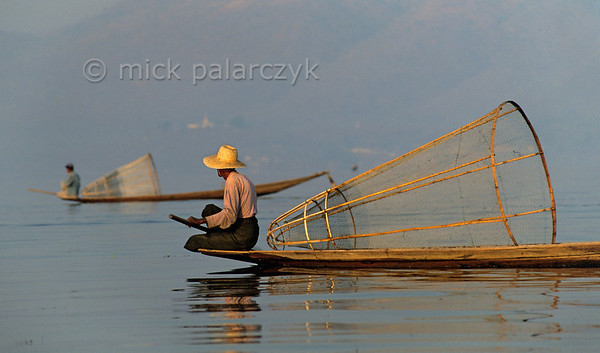 [BURMA 24.836] 'Intha fishermen.'  	Intha fishermen search the Inle Lake for a good spot to start fishing. Photo Mick Palarczyk.
