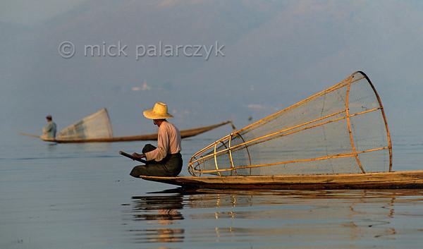 [BURMA 24.836] 'Intha fishermen.'  Intha fishermen search the Inle Lake for a good spot to start fishing. Photo Mick Palarczyk.