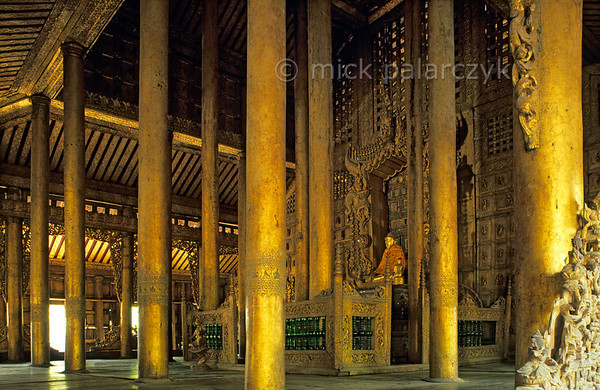 [BURMA 25.103] 'Shwenandaw Monastery.'  	A forest of gilded teak poles carries the roof of the Shwenandaw Monastery at Mandalay. Photo Mick Palarczyk.