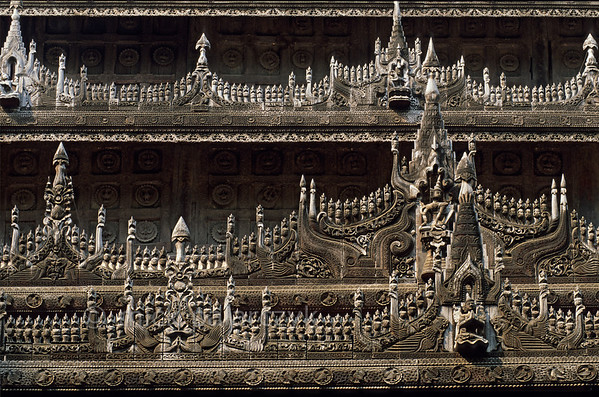 [BURMA 25.101] 'Shwenandaw Monastery.'  	Woodcarvings on the exterior of the Shwenandaw Monastery in Mandalay. Photo Mick Palarczyk.