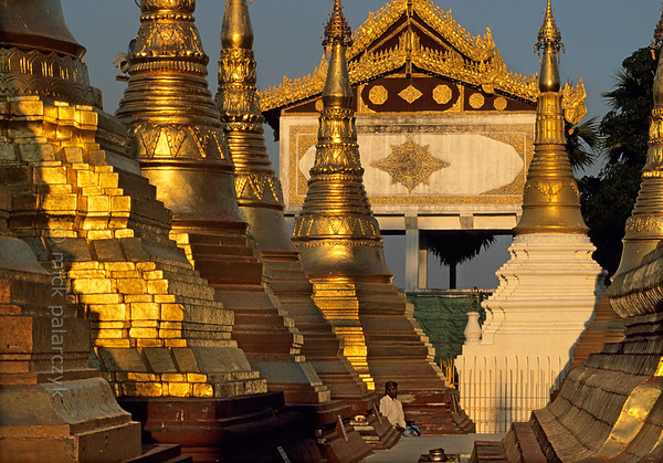 [BURMA 24.695] 'Golden meditation.'  	The terrace around the Naungdawyi Stupa in the northeastern corner of Yangon's Shwedagon temple is open only to meditating men. Photo Mick Palarczyk.