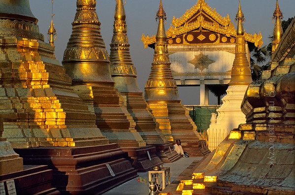 [BURMA 24.693] 'Golden meditation.'  	The terrace around the Naungdawyi Stupa in the northeastern corner of Yangon's Shwedagon temple is open only to meditating men. Photo Mick Palarczyk.