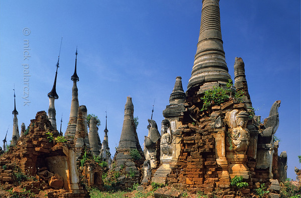 [BURMA 24.865] 'Ruined stupas.'  	At Indein, a village on the west shore of the Inle Lake, the Shwe Inn Thein Pagoda complex (founded in the 11th century) is for the greater part in a dilapidated state. Photo Mick Palarczyk.
