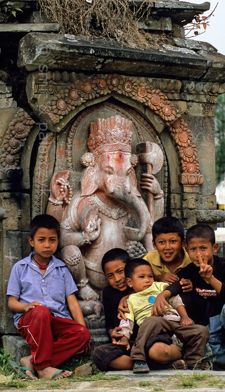 [NEPAL.KATHMANDUVALLEY 27570] 'Ganesh near Sankhu.'  	A statue of Ganesh decorates a road-side shrine north of Sankhu. Photo Paul Smit & Mick Palarczyk.