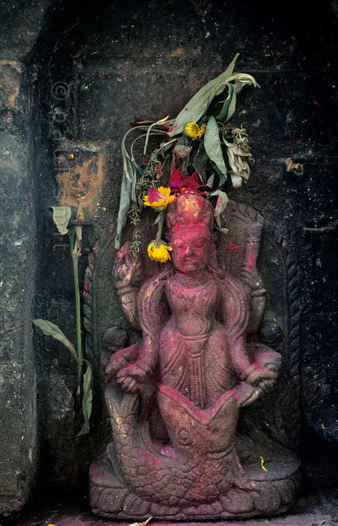 [NEPAL.KATHMANDUVALLEY 27433 'Matsya on Bhaktapur's Hanuman Ghat.'  Statue of Matsya, located on Bhaktapur's Hanuman Ghat. Vishnu, in his incarnation of Matsya the Fish, rescued the sacred Vedas that had been stolen from Brahma and thrown in the ocean. During a deluge he also saved Manu, the Hindu equivalent of Noah, by towing his boat to a mountaintop. Photo Paul Smit.
