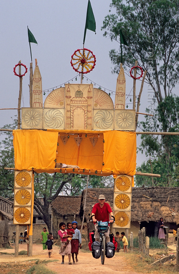 [NEPAL 27588] 'Festival gate near Nepalganj.'  	In Nepal local festivals can be an unexpected colourful experience for western travelers, as here in a Terai village just north of Nepalganj. Photo Mick Palarczyk.
