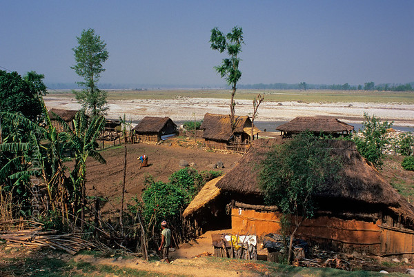 [NEPAL 27597] 'Terai village near Manahari.'  	Near Manahari, in the Terai west of Hetauda, a small village sits on the edge of the wide floodplain of the Karra Khola. Photo Mick Palarczyk.