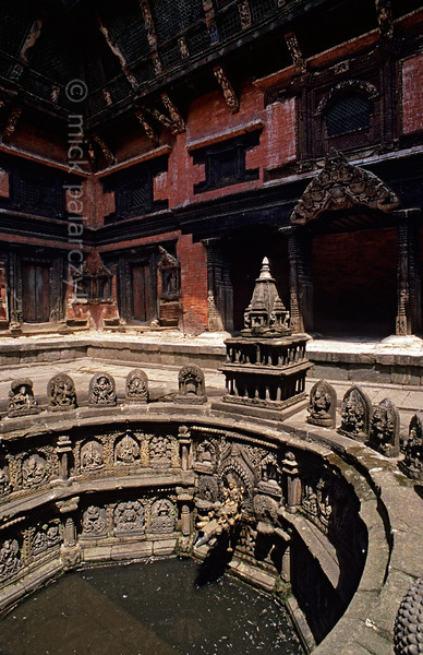 [NEPAL.KATHMANDUVALLEY 27316] 'Royal bath in Patan.'  Tusha Hiti, the 17th century sunken royal bath in the Sundari Chowk courtyard of Patan's Royal Palace is decorated with many images of Hindu gods. The bath was last used by a king of Patan in 1769 when the city was conquered and Patan stopped to be an independent kingdom. Photo Mick Palarczyk.