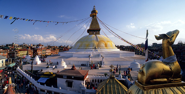 [NEPAL.KATHMANDUVALLEY 27299] 'Boudhanath Stupa.'  	The Stupa of Boudhanath, northeast of Kathmandu, is one of the largest stupas. The dome rests on three plinths of decreasing size, which gives the impression of the stupa as a mandala, or meditation tool. The all-seeing eyes of Adi-Buddha (primordial Buddha) are painted on the four sides of the central spire. Photo Mick Palarczyk.