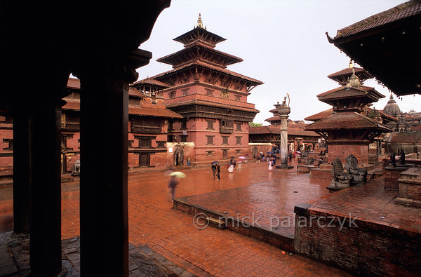 [NEPAL.KATHMANDUVALLEY 27309] 'Royal Palace in Patan.'  	A rainstorm gives the bricks of Patan's Durbar Square a deep red colour. The image shows the facade of the Royal Palace, seen from the lower gallery of the Krishna Temple. Photo Mick Palarczyk.