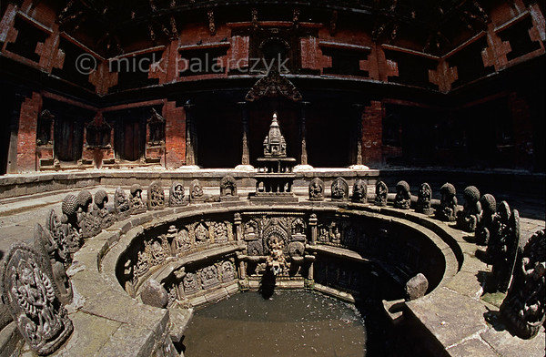 [NEPAL.KATHMANDUVALLEY 27318] 'Royal bath in Patan.'  	Tusha Hiti, the 17th century sunken royal bath in the Sundari Chowk courtyard of Patan's Royal Palace is decorated with many images of Hindu gods. The bath was last used by a king of Patan in 1769 when the city was conquered and Patan stopped to be an independent kingdom. Photo Mick Palarczyk.