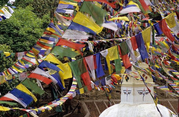 [NEPAL.KATHMANDUVALLEY 27242] 'Prayer flags at Manjushri Hill.'  	Near Swayambhu, west of Kathmandu, prayer flags surround the stupas at Manjushri Hill. Photo Paul Smit.