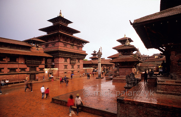 [NEPAL.KATHMANDUVALLEY 27311] 'Royal Palace in Patan.'  	A rainstorm gives the bricks of Patan's Durbar Square a deep red colour. The image shows the facade of the Royal Palace. Photo Mick Palarczyk.