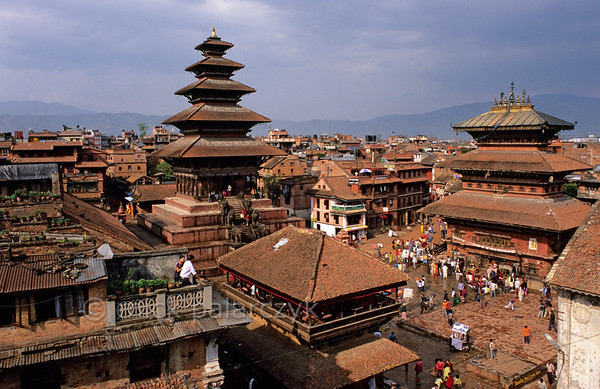 [NEPAL.KATHMANDUVALLEY 27381] 'Bhaktapur's Taumadhi Square.'  Bhaktapur's Taumadhi Square is dominated by the five-tiered Nyatapola Temple (1702) which is dedicated to Siddhilakhsmi, Hindu goddess of prosperity. To the right stands the Bhairava Temple which was constructed in 1717. Photo Mick Palarczyk.