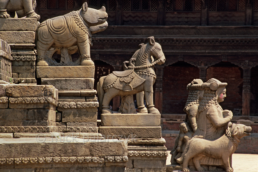 [NEPAL.KATHMANDUVALLEY 27376] 'Siddhilakhsmi Temple in Bhaktapur.'  Pairs of statues line the stairs that climb the pedestal of the 17th century Siddhilakhsmi Temple on Bhaktapur's Durbar Square. Siddhilakhsmi is the Hindu goddess of prosperity. Photo Mick Palarczyk.