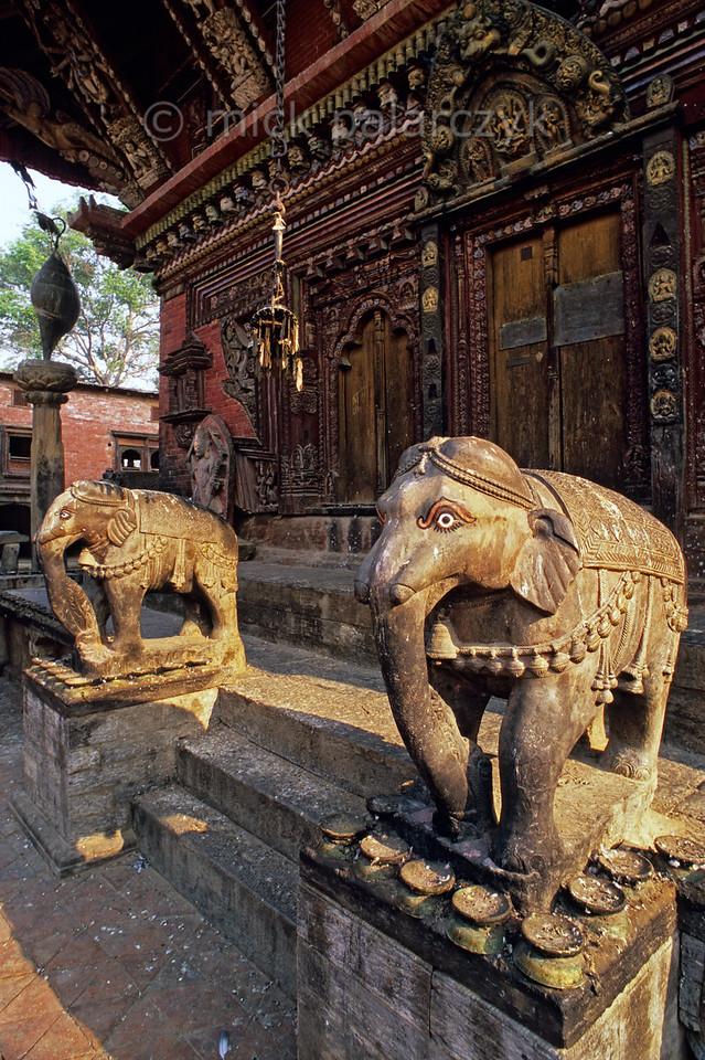 [NEPAL.KATHMANDUVALLEY 27541] 'Elephants at Changu Narayan.'  The southern entrance of the Vishnu Temple (ca. 1700) at Changu Narayan is guarded by two elephants. Photo Mick Palarczyk.
