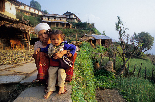 [NEPAL 27152] 'Mother and child in Ghandrung.'  Mother and child in the village of Ghandrung in the Annapurna Conservation Area. Photo Paul Smit.