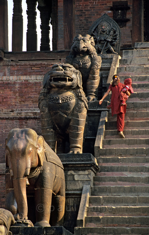 [NEPAL.KATHMANDUVALLEY 27385] 'Stairs of Bhaktapur's Nyatapola Temple.'  	On Bhaktapur's Taumadhi Square five pairs of temple guardians flank the stairs that lead up to the Nyatapola Temple. From bottom to top: the wrestlers Jaya Malla and Patha Malla (not visible here), elephants, lions, griffins and two minor goddesses, Baghini and Singhini. Each pair is supposed to be ten times as strong as the pair below. Photo Paul Smit.