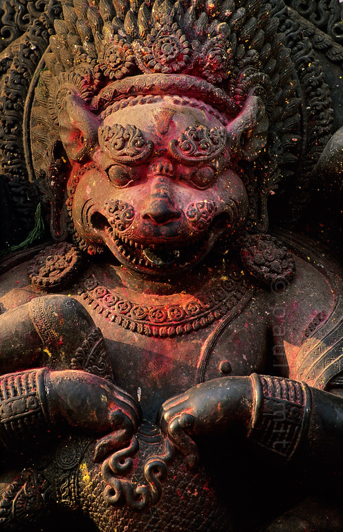 [NEPAL.KATHMANDUVALLEY 27378] 'Narasimha in Bhaktapur.'  	Sculpture of Narasimha (Vishnu as the man-lion avatar) eviscerating the unbeliever Hiranyakashipu, in Bhaktapur's Durbar Square. Red powder has been smeared on the sculpture during puja offerings. Photo Paul Smit.